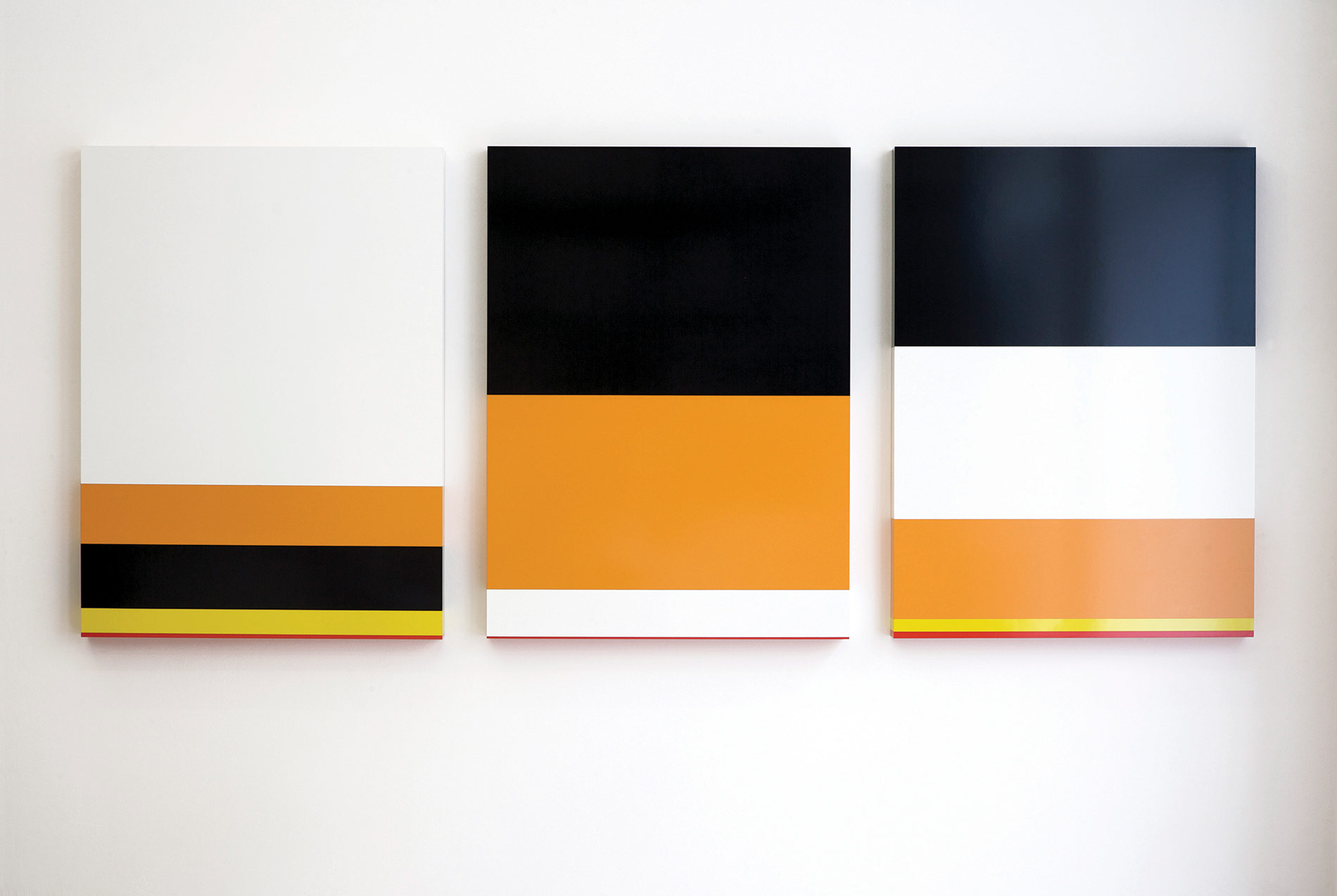 American Colors, 2009. USA population by race, USA poverty rate by race, USA prison population by race. Formica on wood 110 x 82 x 7 cm each