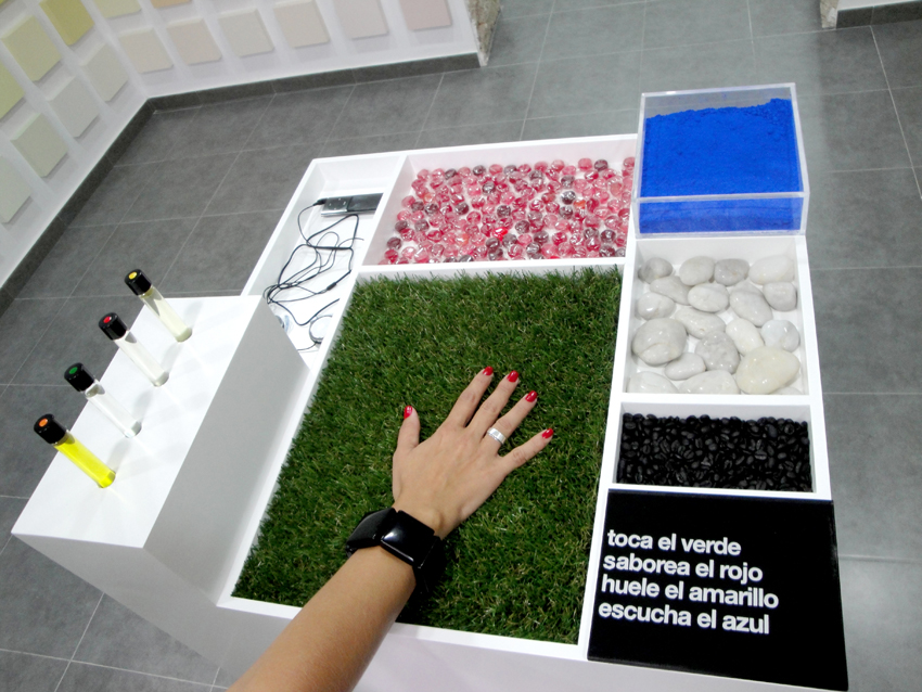 «Synesthesia (Sensations Module)», 2011, Tubes with essences, Ipod, stones, pigment, candies, artificial grass, methacrylate, vinyl and lacquered MD, 122 x 64 x 64 cm